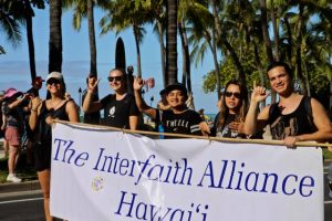 five people carrying a TIAH banner in Martin Luther King Jr. Parade 2017